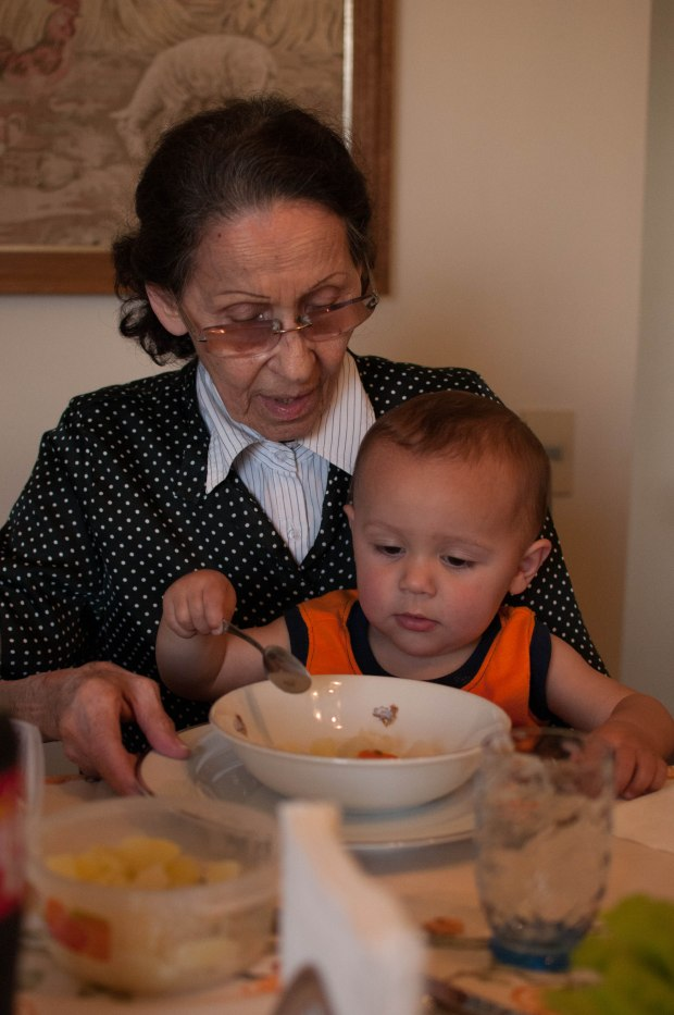great grandma Natercia feeding Shasta from the bowl her children ate from!