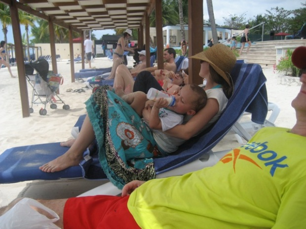 one of mom's pics: having a bottle at the beach