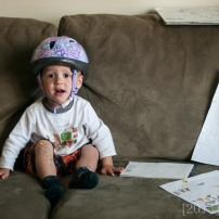 He found some stickers. Also he likes to wear his helmet inside. I have no objections to that!