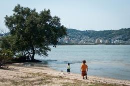 at a beach/playground across the bridge